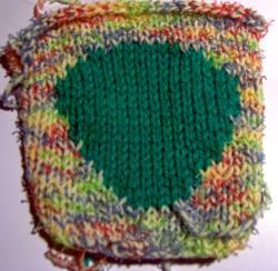 Intarsia-stickat mönster, infälld bild i stickning, flera färger
