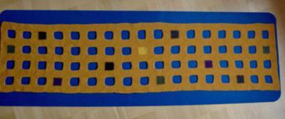 Efter filtningen (en gång i tvättmaskinen, 40 grader) hade sjalen krympt från 223 x 59 cm till 183 x 46 cm. Perfekt!